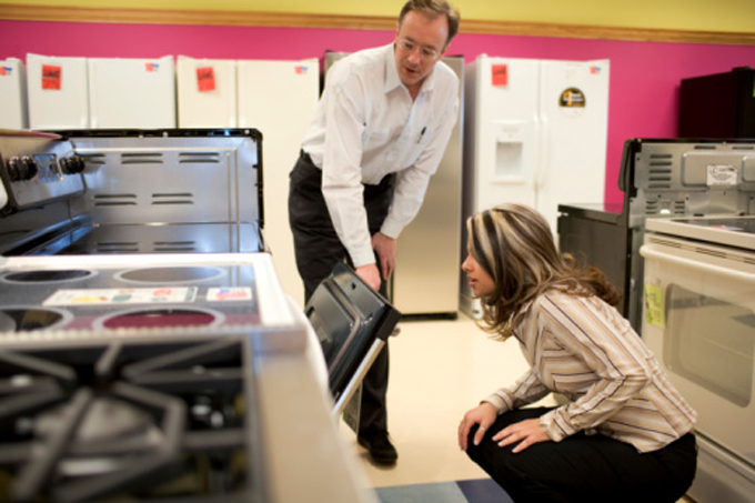 Salesman and woman in appliance store